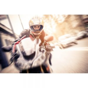 SG2193 man riding motor bike biker speeding streets