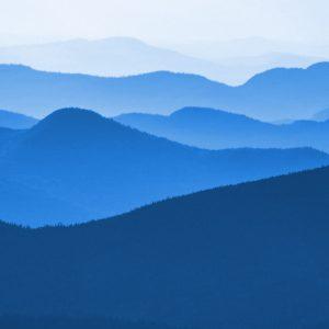 TM2827 hills distance landscape bricght blue